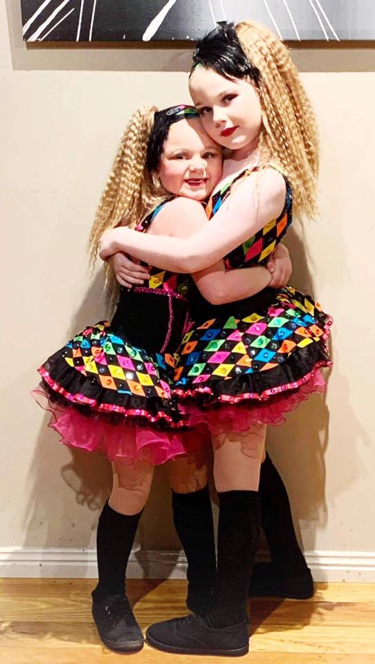 Girls hugging after dancing at a Competitions class located at CV Dance Studio in Bendigo