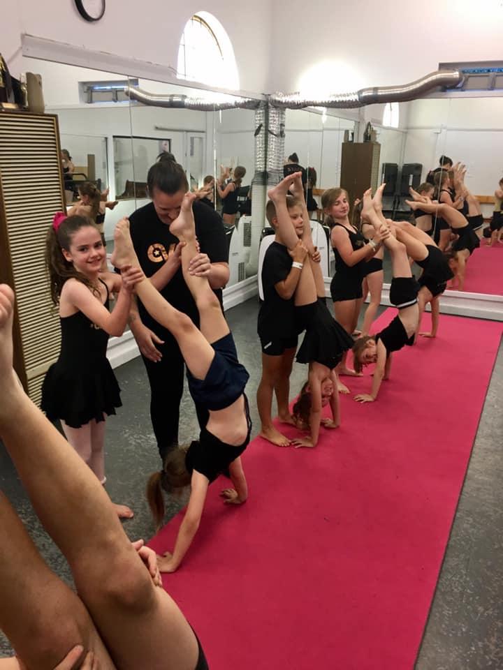Girls upside down dancing at an Acro Acrobatics class located at CV Dance Studio in Bendigo