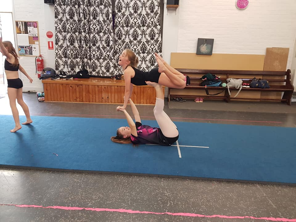 Girls lifting each other up and dancing at an Acro Acrobatics class located at CV Dance Studio in Bendigo