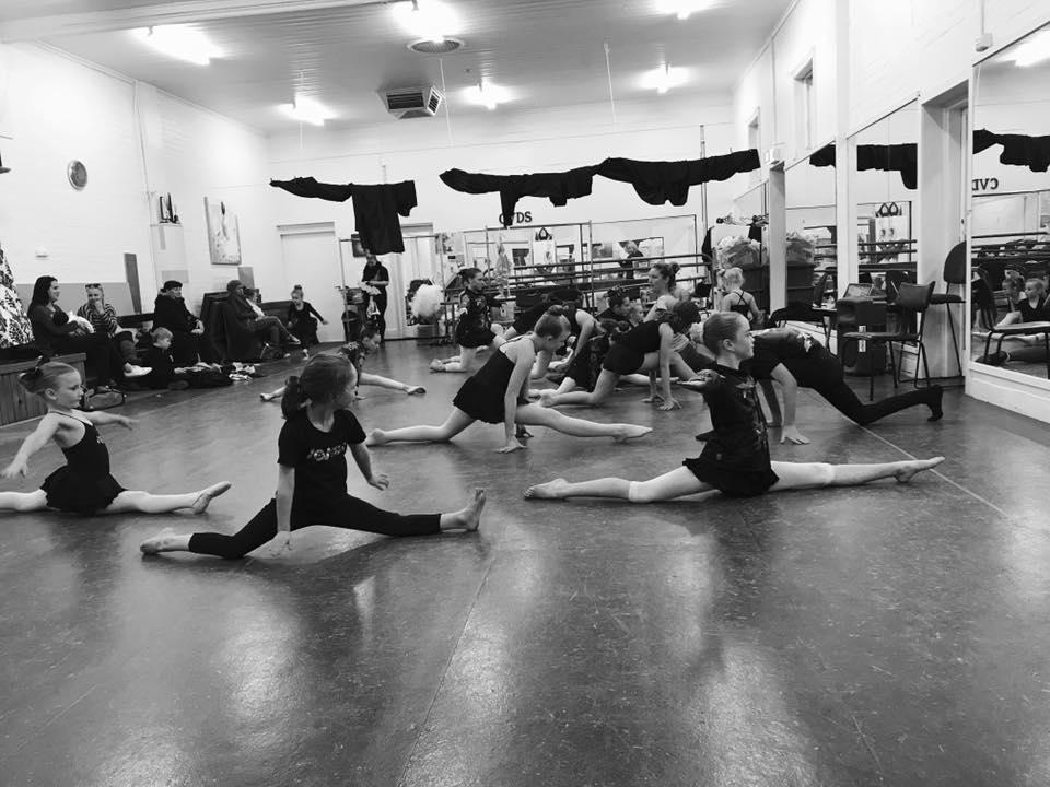 Girls stretching dancing at an Acro Acrobatics class located at CV Dance Studio in Bendigo